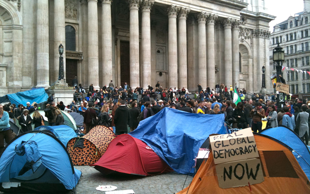 "Neil Cummings, ""Occupy occupy! Global Democracy Now,"" Tents in from of St Paul's Cathedral, London, October 16, 2011. Digital Photograph. Courtesy of the photographer, licensed under the Creative Commons."