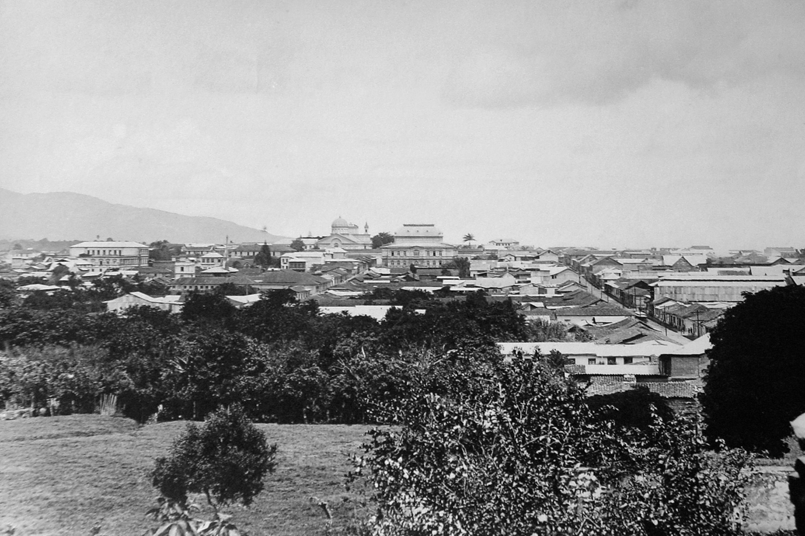 "c.1900. Panoramic view of San José. Transforming San José in line with modern principles was integral to the Liberals' political project: to build a nation-state. At the end of the 19th century, the adoption of a new urban model was a conscious choice by Liberal elites, for whom European theories and practices were the sure road to ""civilization and progress"".  [Photographer: Harrison Nathaniel Rudd, Courtesy of the Architecture School, University of Costa Rica. Collection: Edgar Vargas and Daniel Domínguez.]"