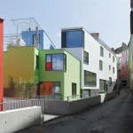 Noua clădire B' cu ferestre largi și culori vii