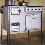 11 Details of the Frankfurt kitchen designed by architect Margarete Schütte-Lihotsky at Römerstadt. The electric stove has oven, spaces for keeping the food warm and a drawer for coals.